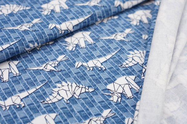 Kuscheliger Baumwoll-Sweat mit weißen Origami Dinosauriern auf blau