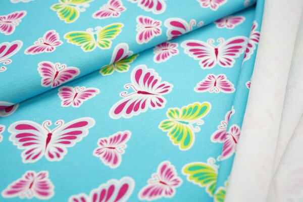 Baumwoll-Sweat Digitaldruck bunte Schmetterlinge auf hellblau