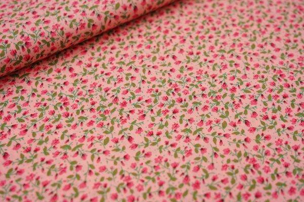 Baumwollstoff kleine Blümchen in koralle rosa / grün auf pastell rosa Blumen