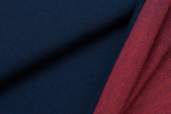 Jacquard-Sweat Ben navy blau Uni mit navy blau amarant pink und orange Rückseite