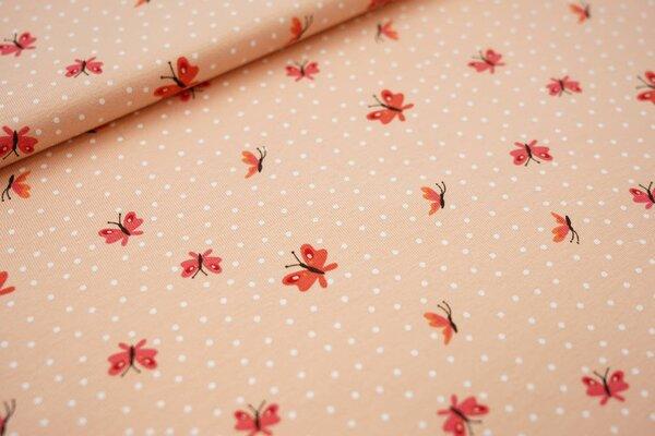 Baumwoll-Jersey Schmetterlinge und weiße Punkte auf lachs