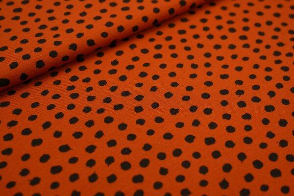 Baumwoll-Jersey schwarze getupfte Punkte auf rostorange