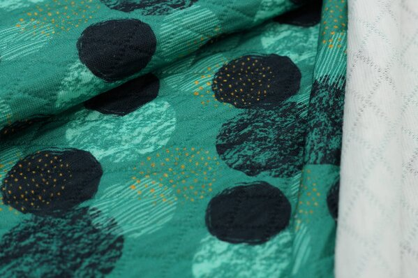Stepp-Stoff Digitaldruck große schwarz / mint Punkte / Kreise auf türkisgrün