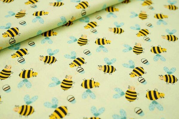 Baumwollstoff mit Bienen und Honigeimern auf hellgrün
