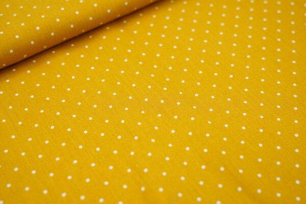 Baumwollstoff kleine weiße Punkte auf senfgelb