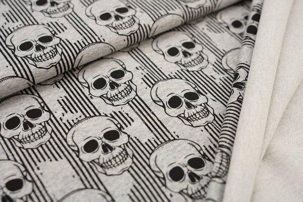 Baumwollsweat schwarze Totenköpfe und Streifen auf grau meliert Totenkopfschädel