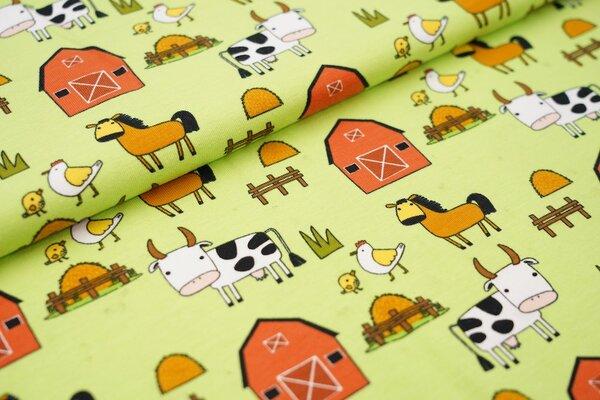 Baumwoll-Jersey mit Bauernhoftieren auf limettengrün Kuh Pferd Huhn Stall