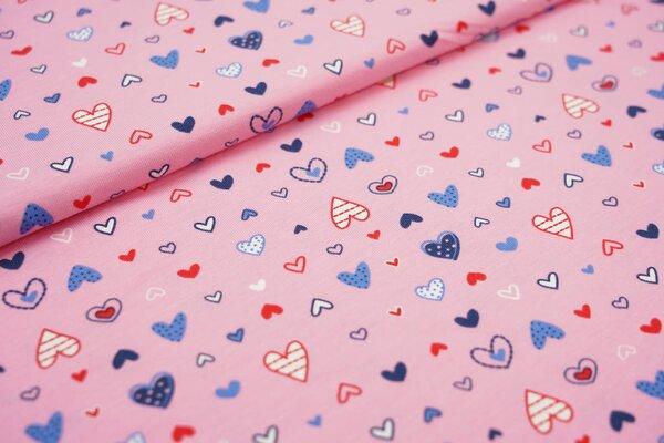 Baumwoll-Jersey bunt gemusterte Herzen auf rosa