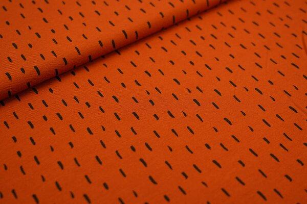 Baumwoll-Jersey schwarze getupfte Striche auf rostorange