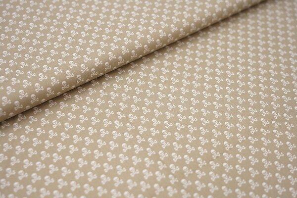 Baumwollstoff Baumwolle beige mit kleinen weißen Totenköpfen