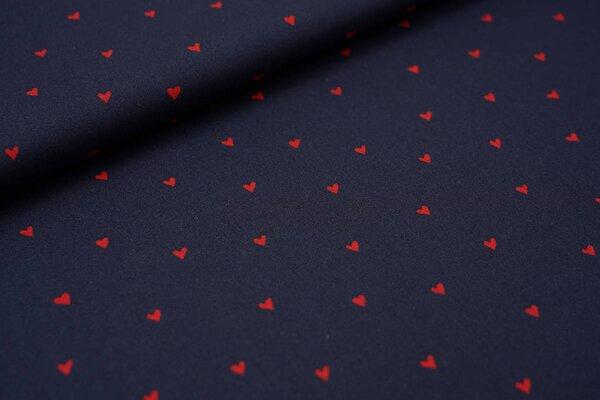 Beschichtete Baumwolle rote Herzen auf dunkelblau