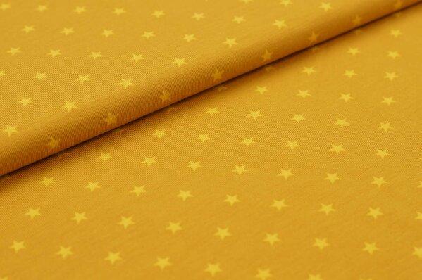 Baumwoll-Jersey kleine Sterne rostsenf / senfgelb