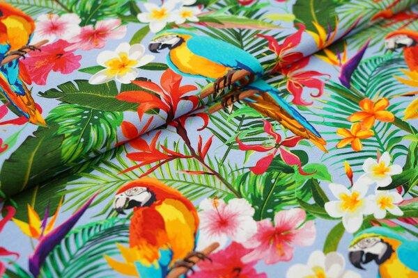 Baumwoll-Jersey Papagei im Dschungel mit bunten Blumen auf hellblau