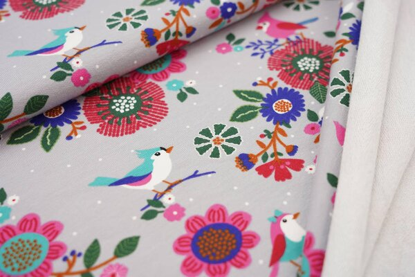 Baumwoll-Sweat Vögel auf Zweigen mit Blumen Punkten auf silbergrau Haubenvogel