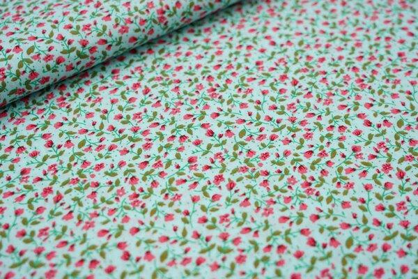 Baumwollstoff kleine Blümchen in koralle rosa / grün auf hellblau Blumen