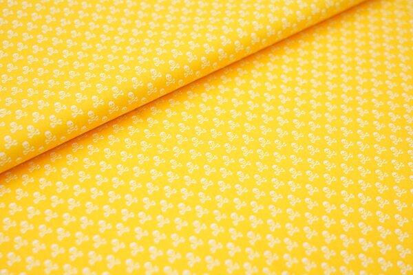 Baumwollstoff Baumwolle gelb mit kleinen weißen Totenköpfen