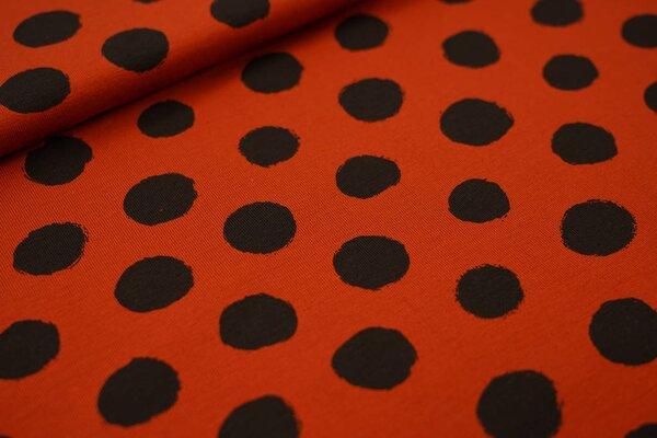 Baumwoll-Jersey große schwarze Punkte auf rostorange