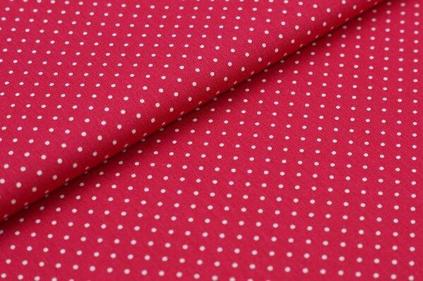 Baumwollstoff Baumwolle amarant pink mit kleinen weißen Punkten